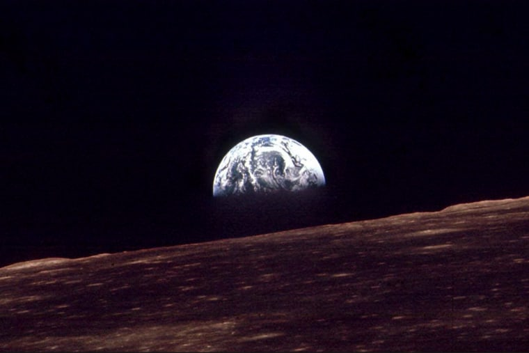 n this Dec. 24, 1968 file photo, the Earth shines over the horizon of the Moon in as seen by the astronauts on Apollo 8.