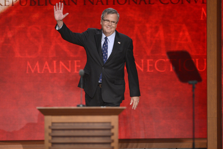 Former Republican Governor of Florida Jeb Bush waves to delegates as he takes the stage at the Republican National Convention at the Tampa Bay Times Forum in Tampa, Fla on Aug. 30, 2012.