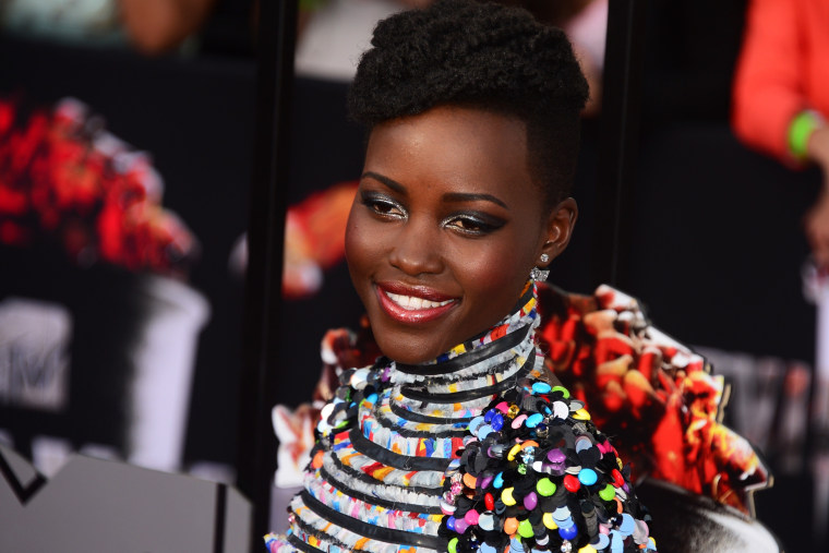 Lupita Nyong'o arrives on the red carpet for the 2014 MTV Movie Awards, April 13, 2014.