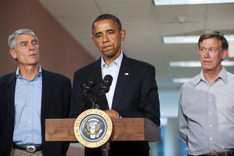 US President Barack Obama speaks alongside Colorado Senator Mark Udall and Colorado Governor John Hickenlooper (R) at the University of Colorado Hospital in Aurora, Colorado, July 22, 2012.