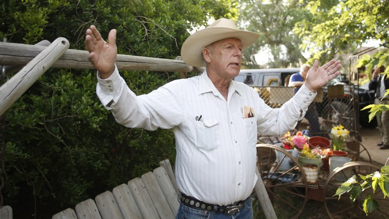 Rancher Cliven Bundy gestures at his home in Bunkerville, Nevada on April 12, 2014.