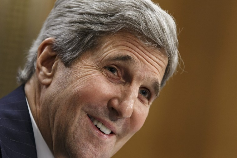 Secretary of State John Kerry smiles as he testifies on Capitol Hill in Washington, April 8, 2014.