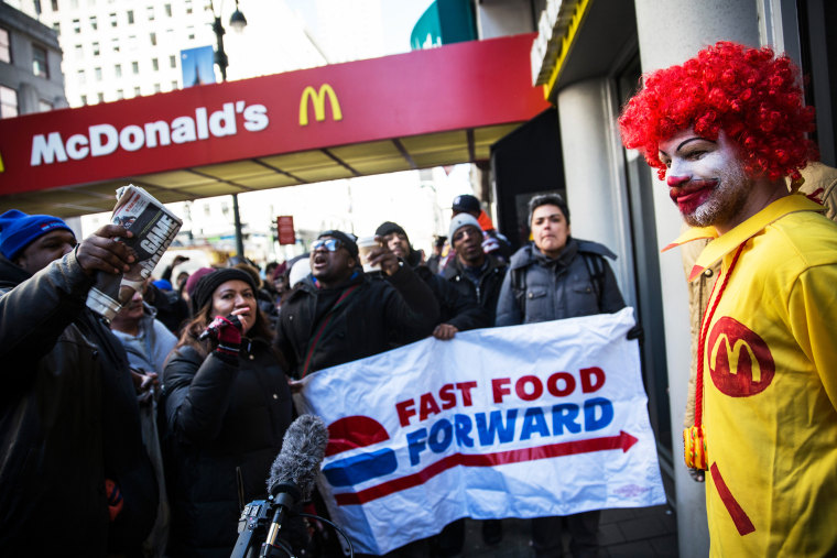 A man dressed as the McDonald's mascot participates in a protest for higher wages for fast food workers on March 18, 2014 in New York City.
