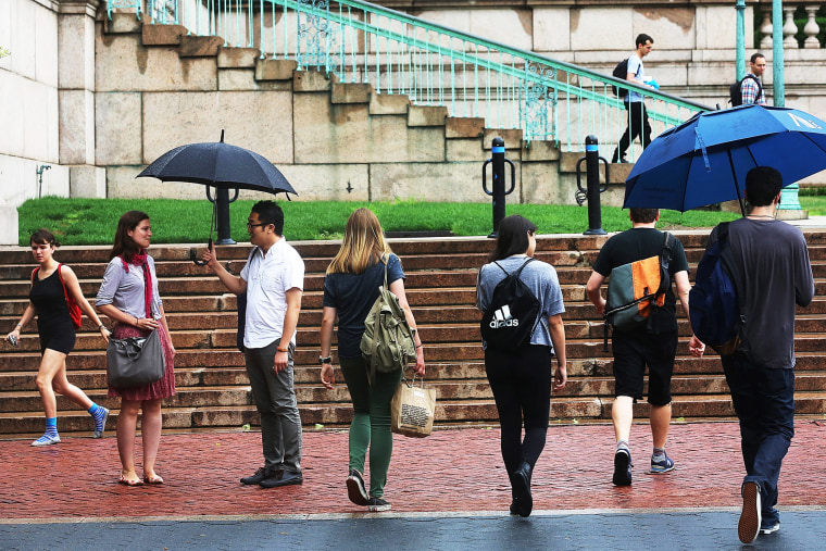 People walk on the Columbia University campus on July 1, 2013 in New York City.