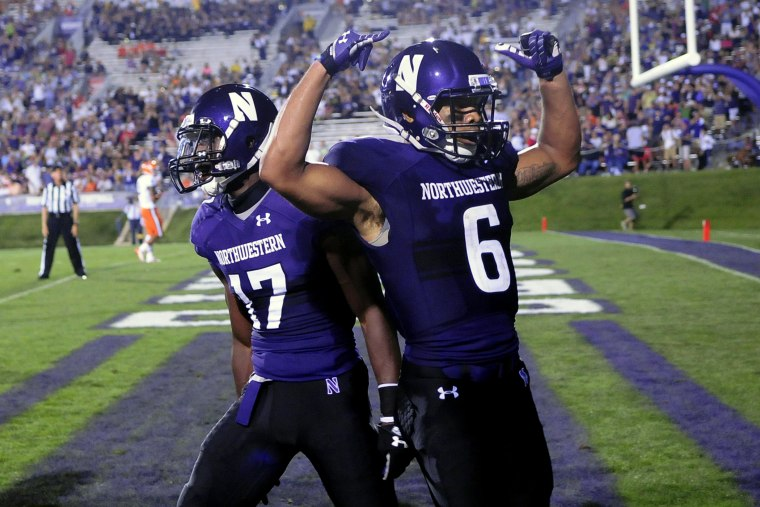 Northwestern players celebrate a touchdown during a game against Syracuse University in Evanston, Ill, Sept.7, 2013.