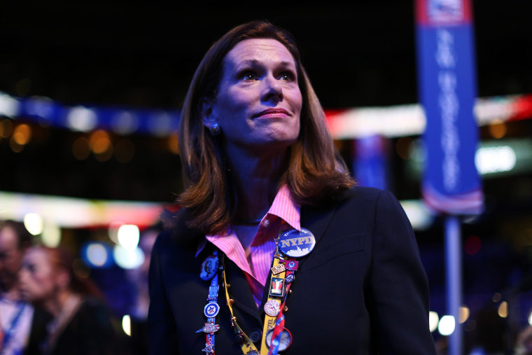 A woman watches the program during the third day of the Republican National Convention in Tampa, August 29, 2012.