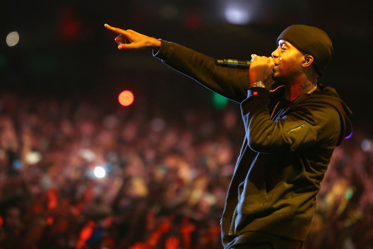 Rapper Nas performs onstage during the 2014 Coachella Valley Music & Arts Festival at the Empire Polo Club on April 12, 2014.