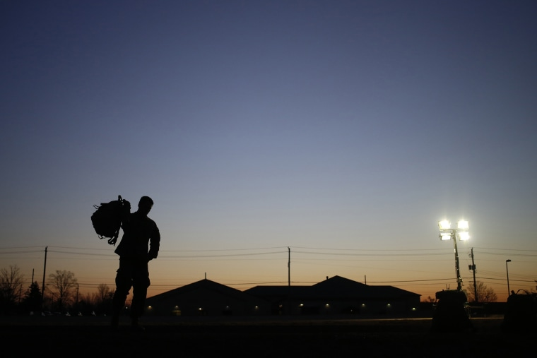 A soldier grabs his rucksack following a homecoming ceremony in Fort Knox, Kentucky.