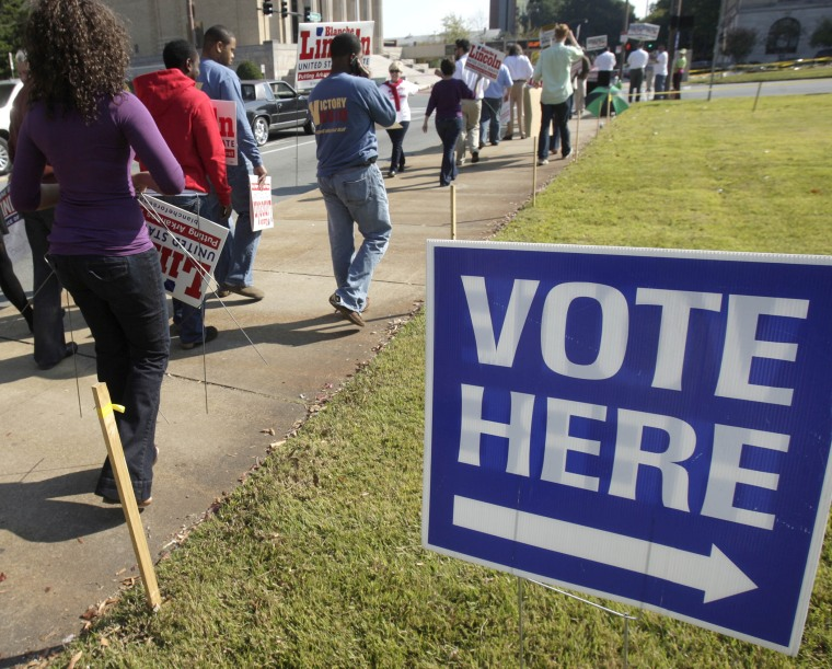 Campaign workers and volunteers walks past an early voting polling place in Little Rock, Ark., Monday, Oct. 18, 2010.