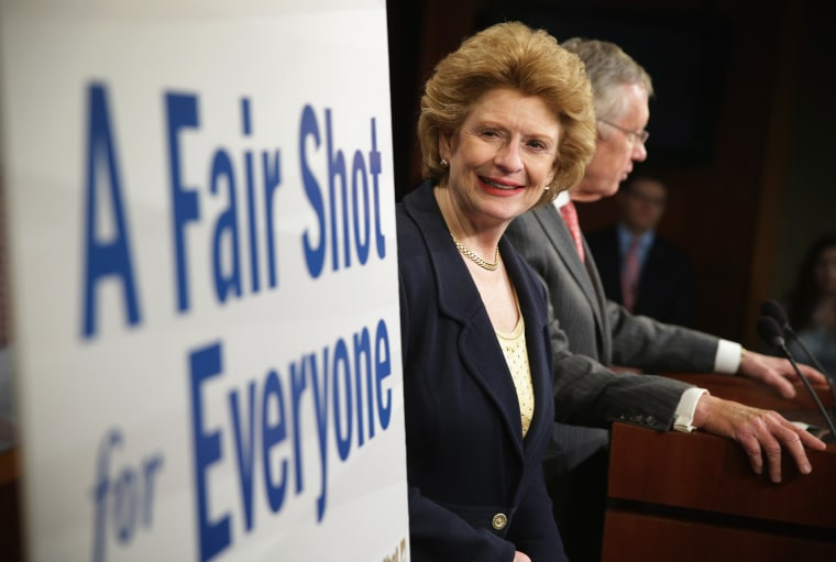 Sen. Debbie Stabenow (D-MI) looks at a poster during a news conference March 26, 2014 on Capitol Hill in Washington, D.C.