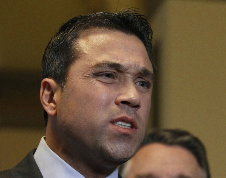 U.S. Representative Michael Grimm (R-NY) talks to the media after a meeting at the U. S. Capitol in Washington, in this  January 2, 2013 file photo.