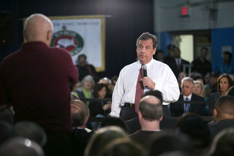 New Jersey Gov. Chris Christie addresses the audience gathered at Winston Churchill Elementary School in Fairfield, NJ for another in his series of town hall meetings, April 9, 2014.