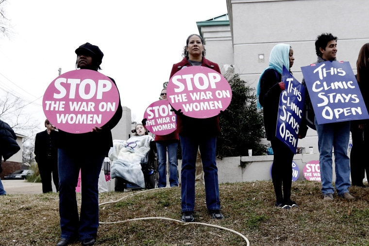 Abortion rights supporters stand outside the Jackson Women's Health Organization Inc., in Jackson, Miss., on Jan. 22, 2013.