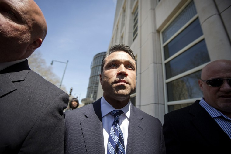 U.S. Representative Michael Grimm (R-NY) exits the Brooklyn Federal Courthouse in the Brooklyn Borough of New York on April 28, 2014.