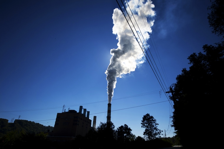 A plume of exhaust extends from the Mitchell Power Station, a coal-fired power plant in New Eagle, Pennsylvania, Sept. 24, 2013.