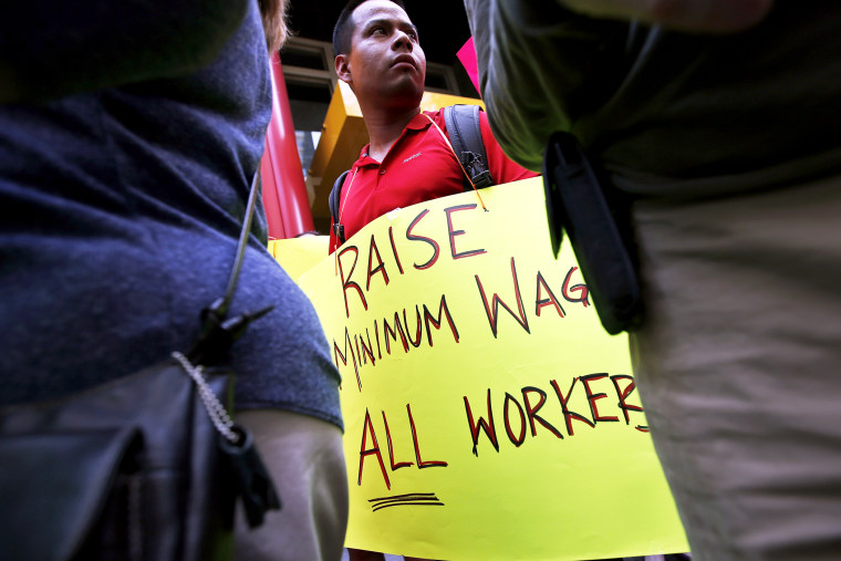 Low wage workers take part in a protest organized by the Coalition for a Real Minimum Wage in New York, May 30, 2013.