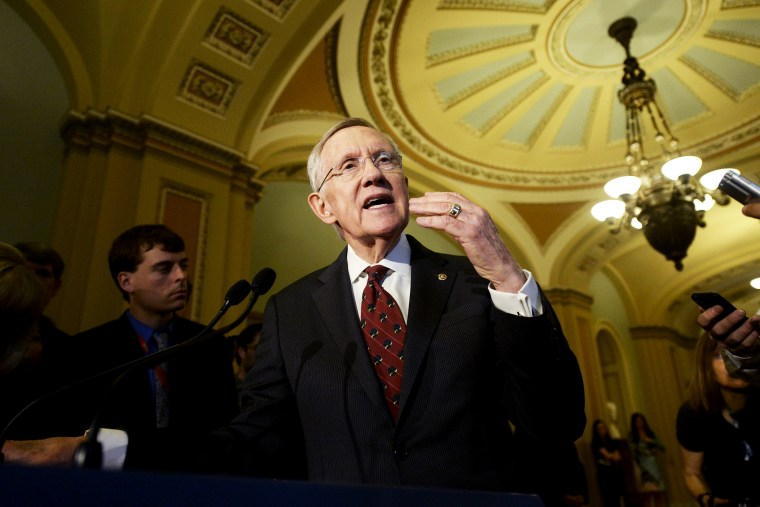 Harry Reid, responds to questions from the news media following a Democratic policy luncheon, April 29, 2014.