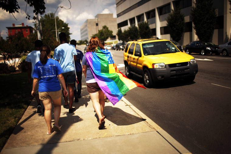 Same-sex marriage supporters leave a protest in Raleigh, N.C.