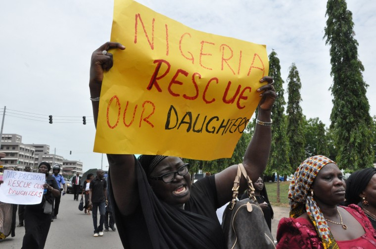 An unidentified mother cries out during a demonstration with others who have daughters among the kidnapped school girls of government secondary school Chibok, April 29, 2014, in Abuja, Nigeria.