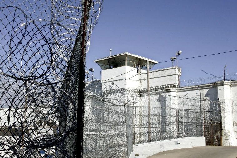 A guard tower and razor wire at the Oklahoma State Penitentiary in McAlester, Okla.
