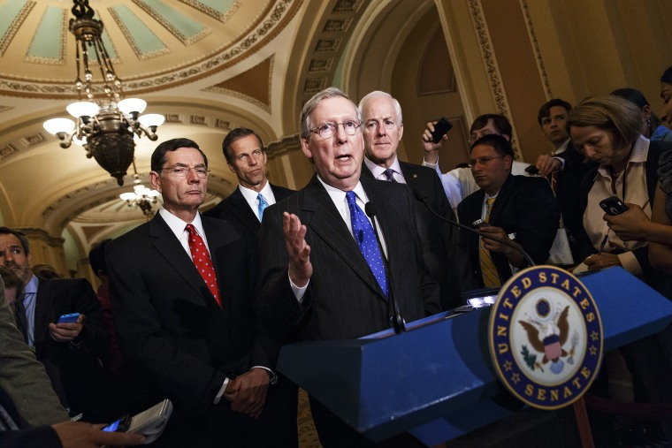 Senate Minority Leader Mitch McConnell and GOP lawmakers talk to reporters after a GOP caucus meeting, April 29, 2014.