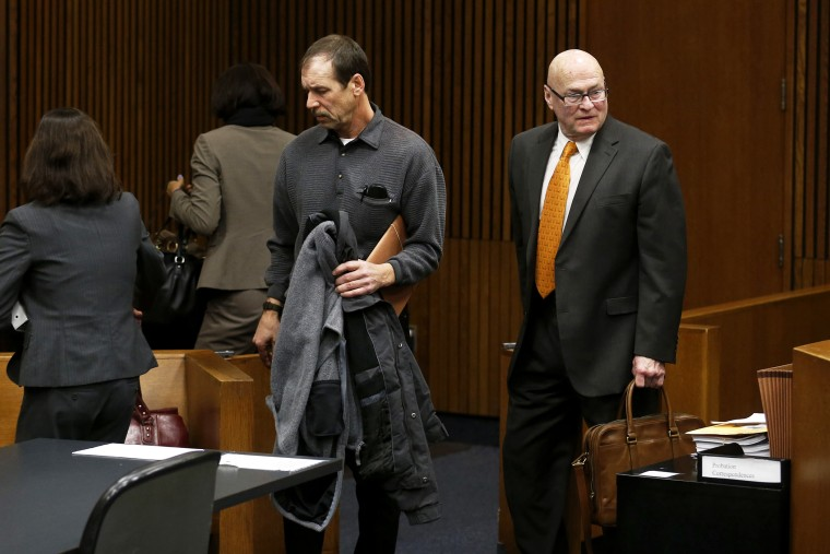 Theodore Wafer (C) and his attorneys Cheryl (L) and Mack Carpenter leave the courtroom after his arraignment in Detroit, Jan. 15, 2014.