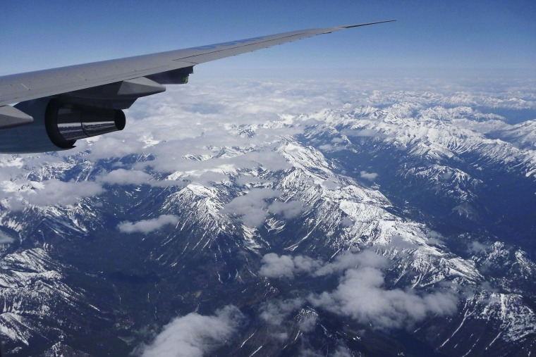 A plane flies over the Cascade Range as it heads towards Seattle.