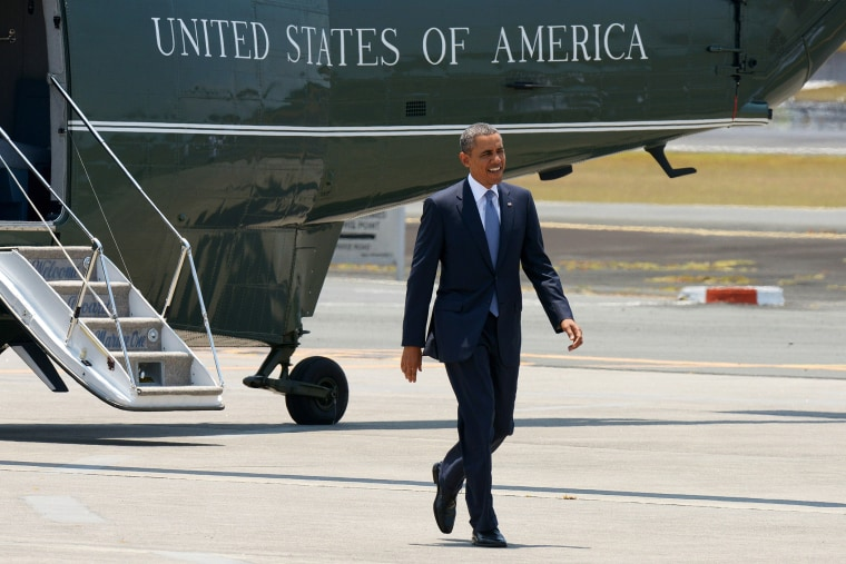 US President Barack Obama walks from Marine One to Air Force One, April 29, 2014.