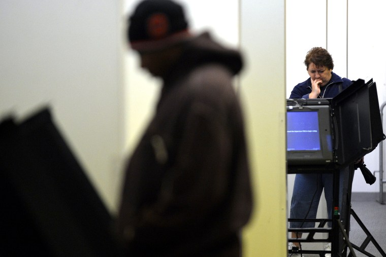 People cast their ballots for the presidential election at an early voting center in Columbus, Ohio, on Oct. 15, 2012.