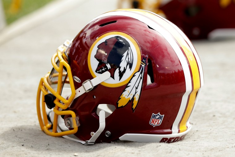 Washington Redskins helmets lay on the ground during their game against the Oakland Raiders at on September 29, 2013 in Oakland, Calif.