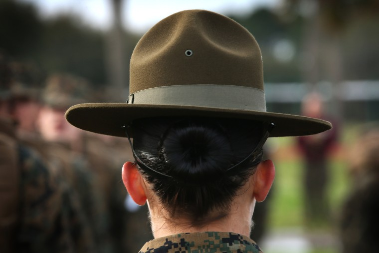 A drill instructor speaks to her female Marine recruits during boot camp, Feb. 27, 2013.