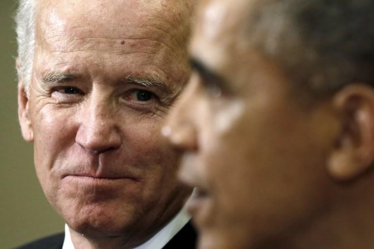 U.S. Vice President Joe Biden (L) listens as President Barack Obama speaks at the White House in Washington on Jan. 22, 2014.