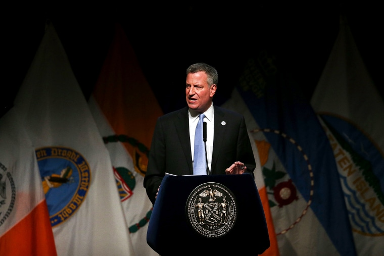 New York Mayor Bill de Blasio delivers a speech to mark his first 100 days in office at Cooper Union on April 10, 2014.