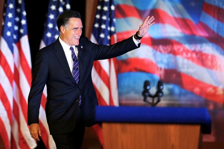 Mitt Romney waves to the crowd before conceding the presidency on November 7, 2012 in Boston, Massachusetts.