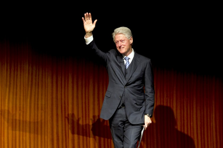 Former President Bill Clinton waves after giving a speech during the Civil Rights Summit at the LBJ Presidential Library, April 9, 2014 in Austin, Texas.
