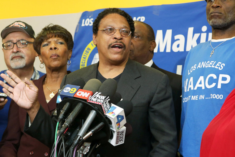 Leon Jenkins, center, president of the Los Angeles chapter of the NAACP speaks at a news conference in Culver City, Calif., April 28, 2014.