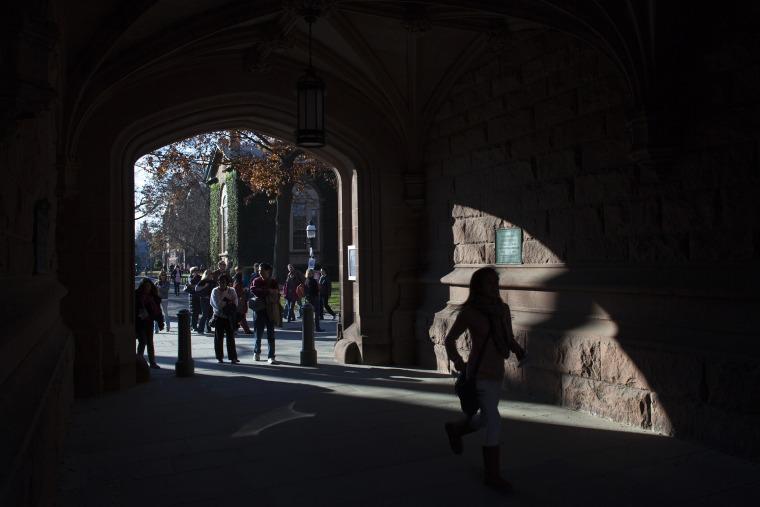 People walk around the Princeton University campus in New Jersey, Nov. 16, 2013.
