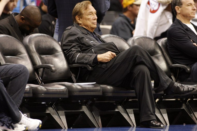 In this April 4, 2010, file photo, Los Angeles Clippers owner Donald Sterling sits court side during the NBA basketball game between the New York Knicks and the Los Angeles Clippers.