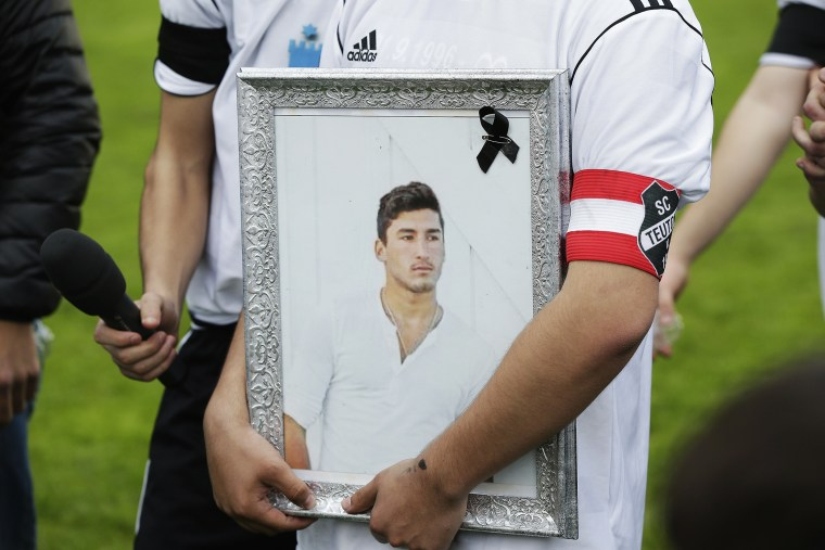 Team-mates, friends and relatives gather to remember Diren Dede at his football club, SC Teutonia 1910, on April 30, 2014 in Hamburg, Germany.