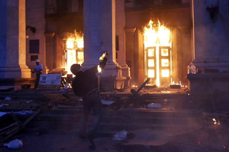 A protester throws a petrol bomb at the trade union building in Odessa May 2, 2014.