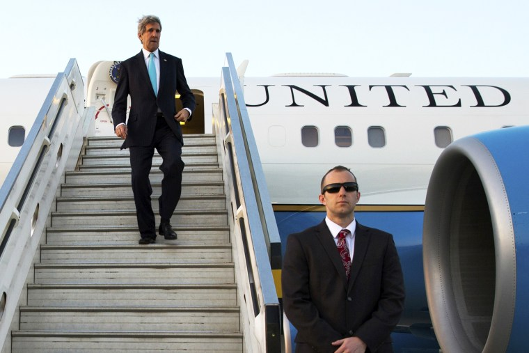 U.S. Secretary of State John Kerry disembarks from his plane, March 31, 2014.