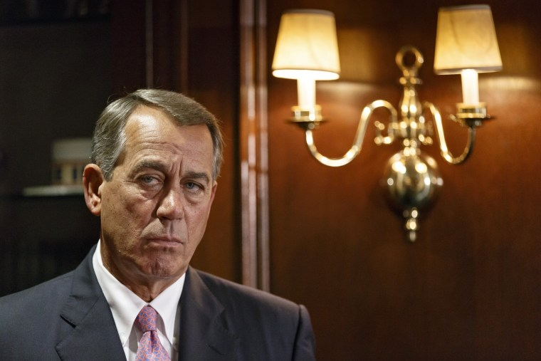 House Speaker John Boehner listens as GOP leaders speak to reporters following a Republican strategy meeting on Capitol Hill in Washington, Tuesday, April 29, 2014.