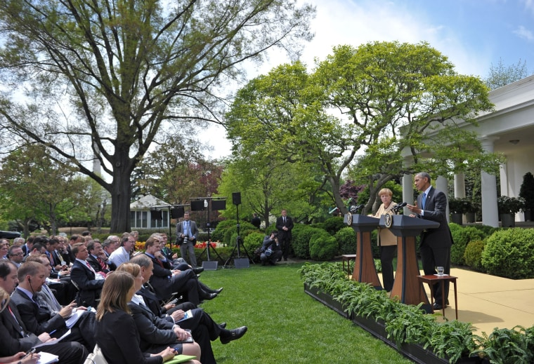 President Barack Obama speaks during a joint press conference with German Chancellor Angela Merkel in the Rose Garden of the White House on May 2, 2014 in Washington, D.C.
