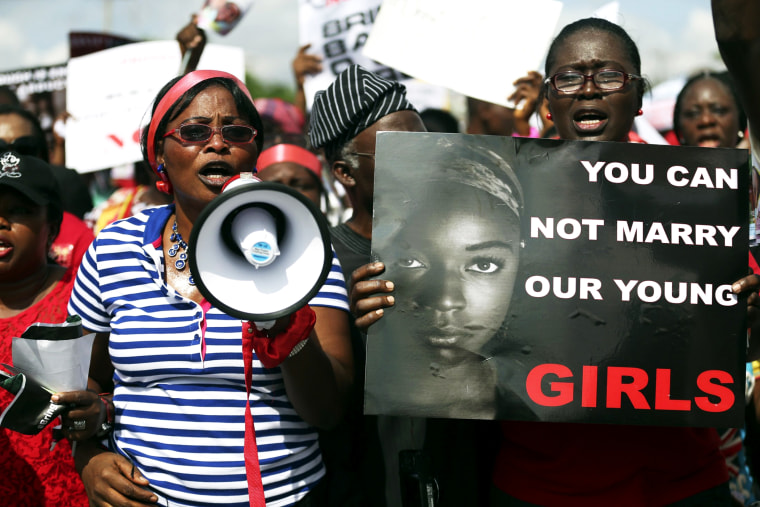 Women holding signs take part in a protest demanding the release of abducted secondary schoolgirls from the remote village of Chibok, in Lagos May 5, 2014.