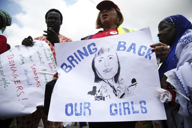 People take part in a protest demanding the release of abducted secondary schoolgirls from the remote village of Chibok, in Lagos May 5, 2014.