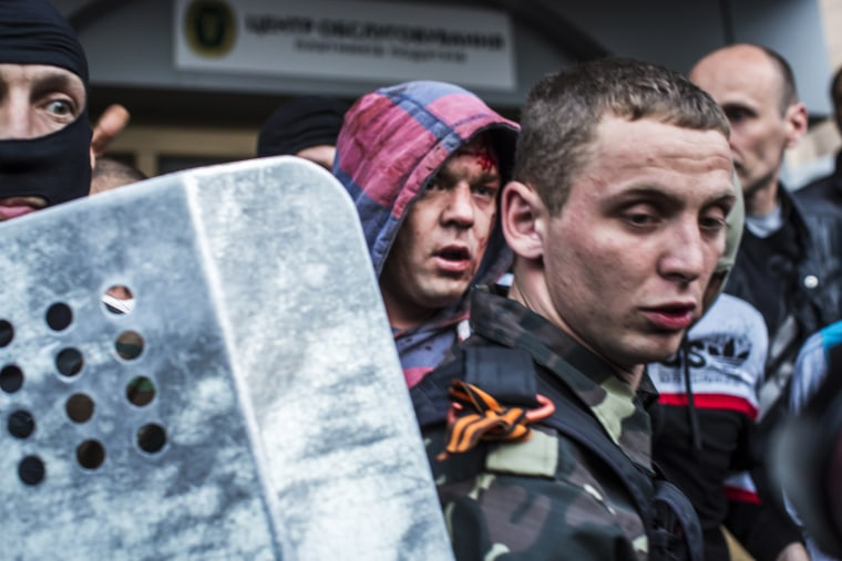 Pro-Russian protesters detain a man who was beaten and accused of being a provocateur outside the Executive Council building on May 4, 2014 in Donetsk, Ukraine.