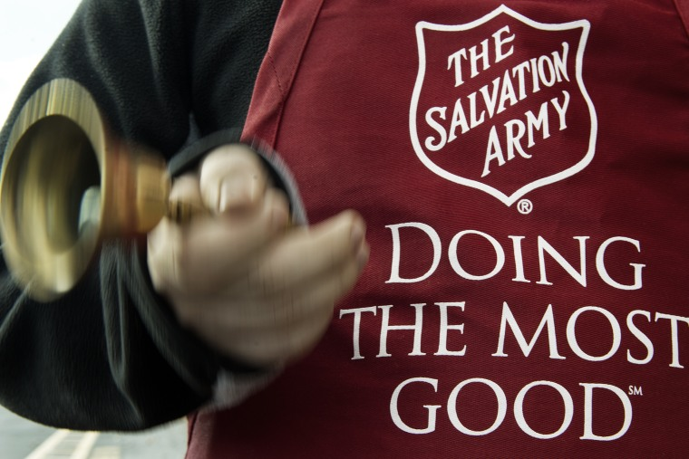 A Salvation Army volunteer rings the collection bell on November 24, 2012.