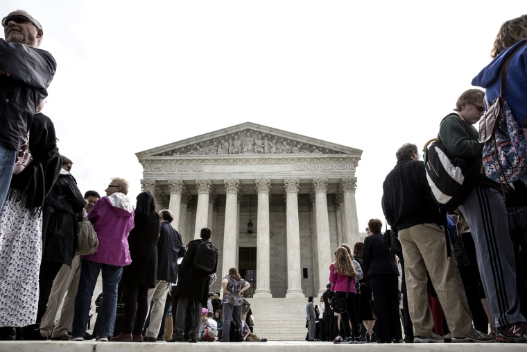 Members of the public wait in line to hear oral arguments at the Supreme Court in Washington.