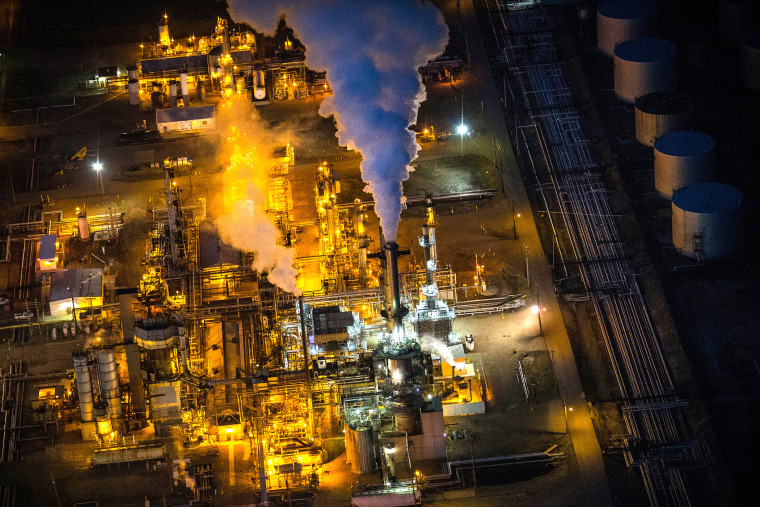 A gas and oil refinery is seen in an aerial view in the early morning hours of July 30, 2013 in Bismarck, North Dakota.