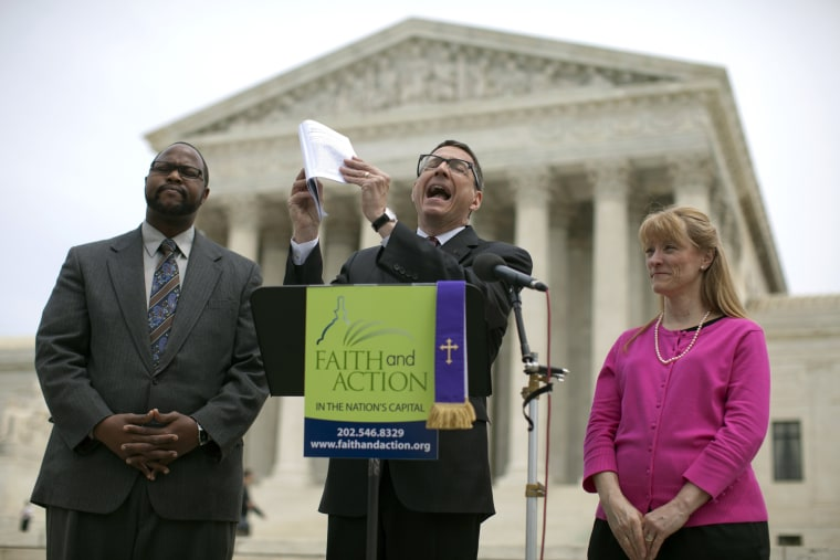 Reverend Dr. Rob Schenck, of Faith and Action, center, speaks in front of the Supreme Court with Raymond Moore, left, and Patty Bills, both also of Faith and Action, during a news conference, Monday, May 5, 2014, in Washington.